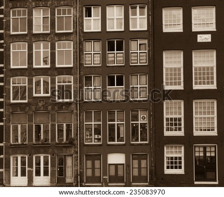 Facades of houses in old city in Amsterdam. Retro colors - stock photo