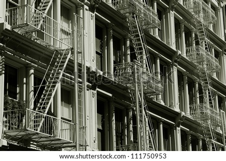 Facades of the historic buildings of the SoHo, with typical iron ladders