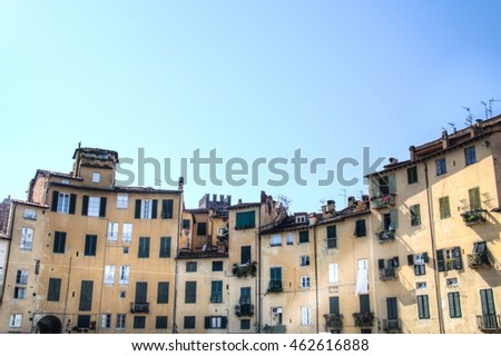 Facades on to the romantic Piazza dell' Anfiteatro square in Lucca in Italy