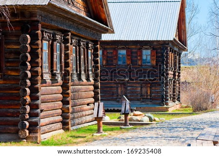 Facades Russian village of wooden houses in the old style - stock photo