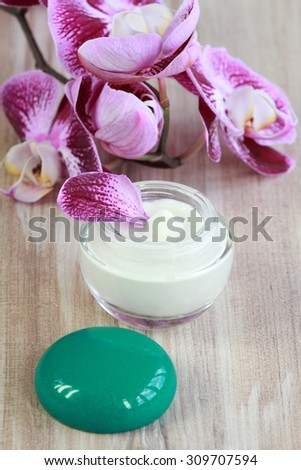 Face and body cream with orchid - stock photo