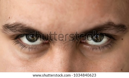 Face and eyes of a young handsome man with expressive eyes closeup