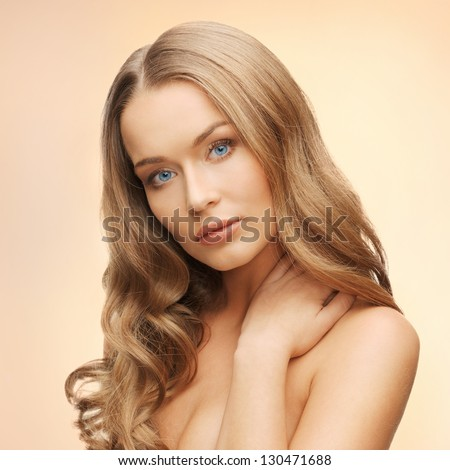 face and hands of beautiful woman with long hair - stock photo