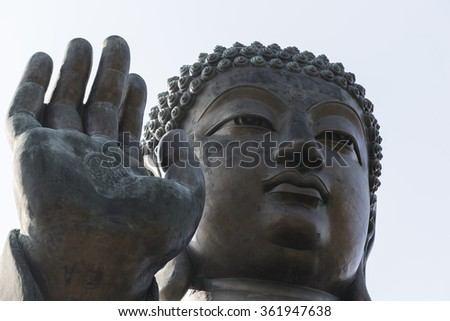 Face and Hands of the Giant Buddha at Po Lin temple,  in Hong Ko