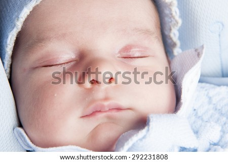 Face close up of a new born baby - stock photo