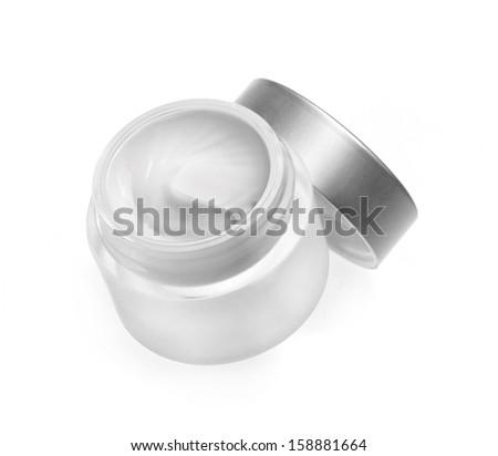 Face cream isolated on white - stock photo