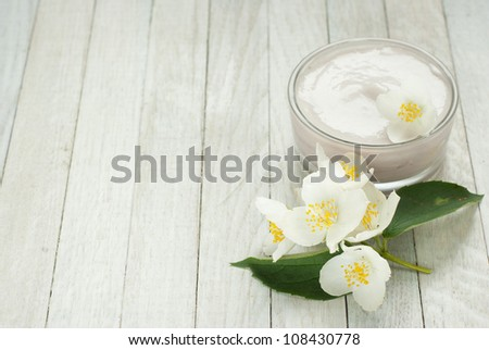 face cream moisturizers with jasmine flowers on white wooden, top view - stock photo