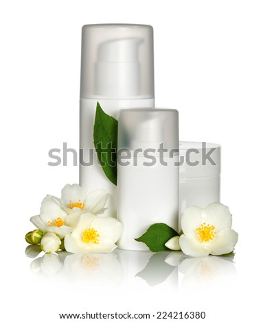Face cream with jasmine flowers on white background