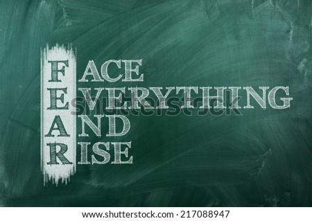 face everything and rise - FEAR acronym on green chalkboard