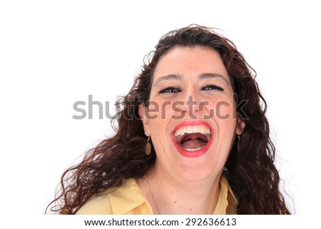 Face forward headshot of a laughing Spanish woman with dark hair brown eyes wearing a yellow blouse