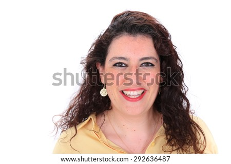 Face forward headshot of a Spanish woman with dark curly hair brown eyes wearing a yellow blouse