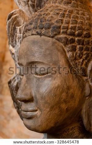 Face front of stone Buddha seen in a temple in Angkor Wat - stock photo