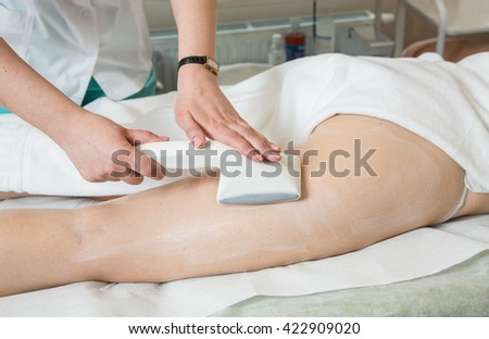 Face laser treatment in a professional beauty studio - stock photo