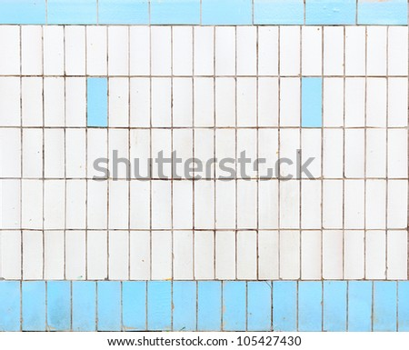 Face-like blue and white tile wall outside
