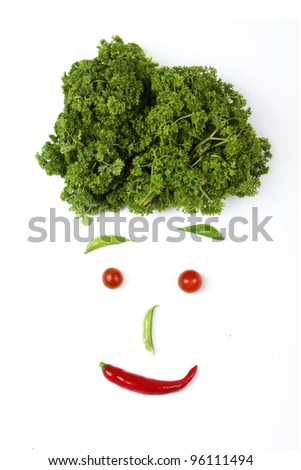 Face made out of different vegetables, shot in studio isolated on white background - stock photo