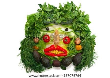Face made with healthy organic vegetables - stock photo