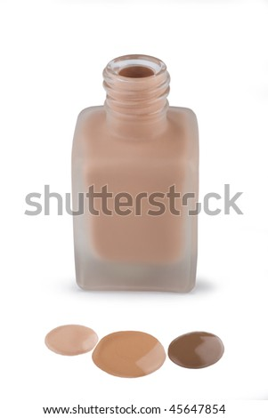 Face make-up in glass matte bottle and three drops of Foundation cream, close-up on white background. - stock photo