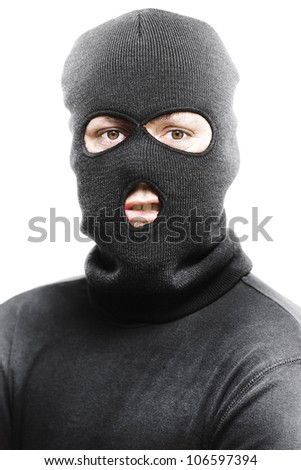 Face of a angry burglar wearing a black ski mask or balaclava isolated on white background - stock photo