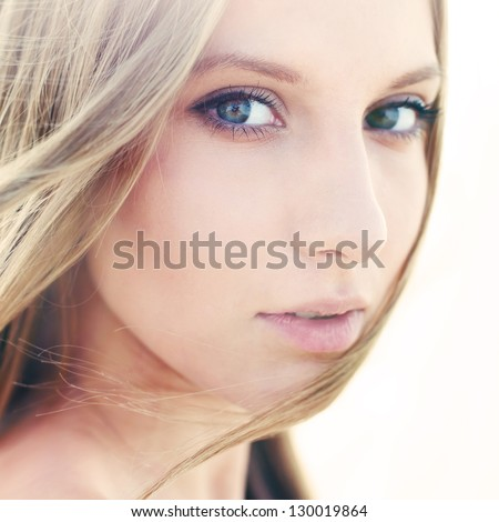 face of a beautiful girl with perfect skin closeup - stock photo