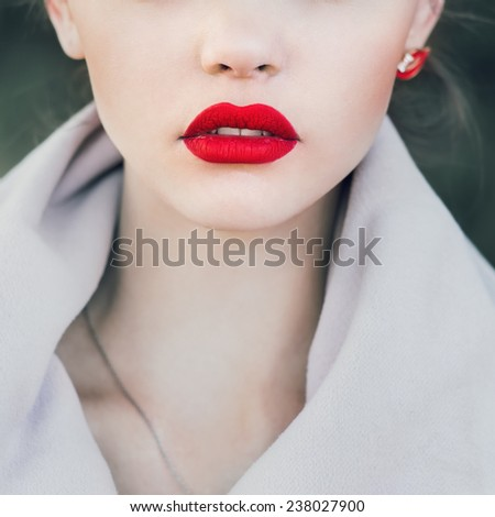 face of a beautiful girl with red lips - stock photo
