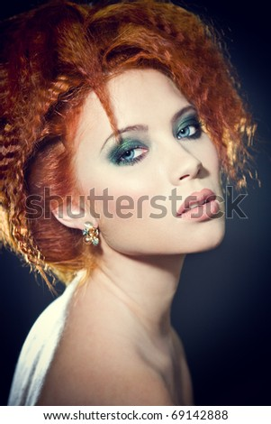 Face of a beautiful redhead woman with perfect makeup - stock photo