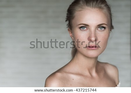 face of a beautiful sexy blonde with bare shoulders close-up