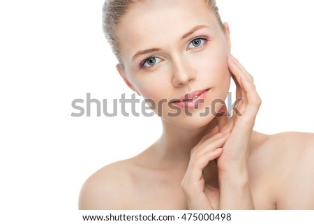Face of a beautiful young woman on a white background