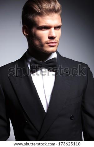 face of a handsome caucasian man in tuxedo posing in studio - stock photo