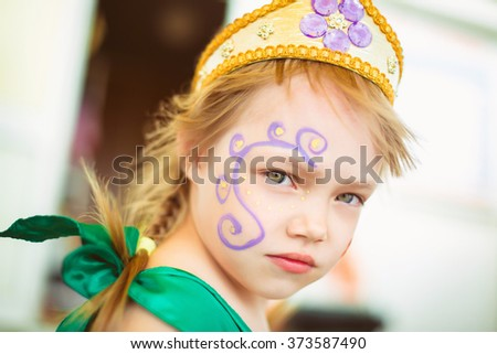 Face of a little girl with a picture - stock photo