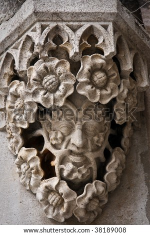 Face of a man with flowers, stone architectural element