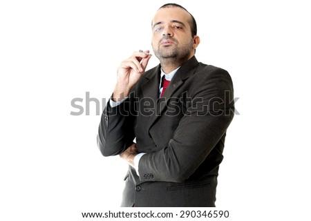 Face of a Serious Business man smoking - stock photo