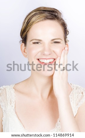 Face Of A Smiling Bride With Perfect Makeup In A Depiction Of Wedding Make-up - stock photo