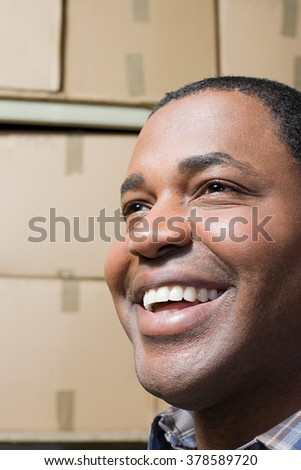 Face of a smiling man - stock photo