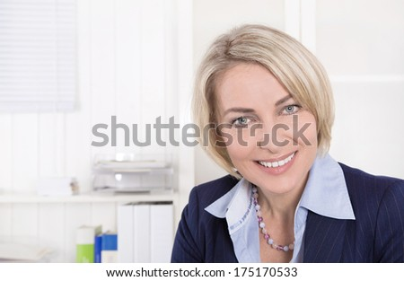 Face of a successful mature business woman in the office.