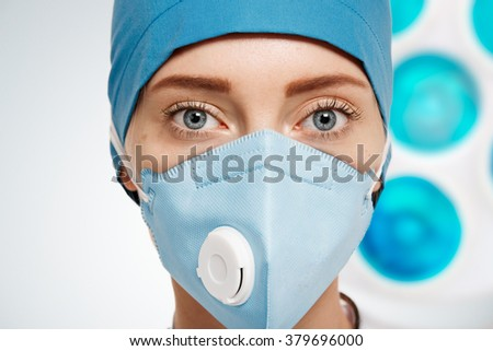 face of a woman doctor in a mask
