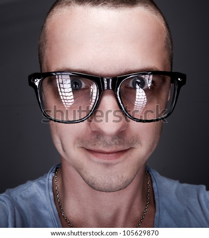 Face of a young handsome man with glasses. Close-up - stock photo