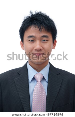 Face of asian business man with friendly smile - stock photo