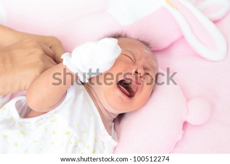 face of baby infant in emotion sign - stock photo