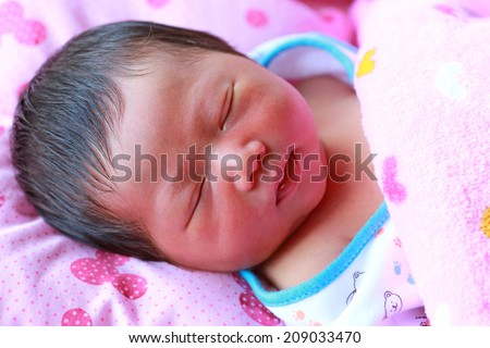 face of baby infant sleep in the blanket - stock photo