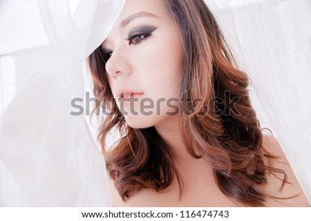 Face of beautiful Asian, Thai, woman covered with veil
