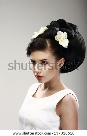 Face of Beautiful Brunette Bride Fashion Model. Elegant Hairdo with Vernal Flowers - stock photo