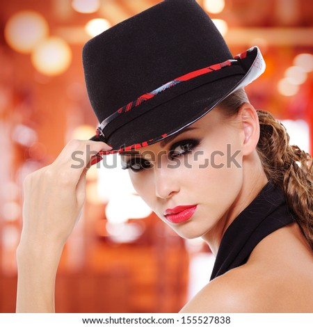 Face of beautiful sexy woman with red lips and fashionable black hat - stock photo