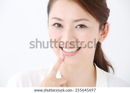 face of beautiful woman showing her teeth