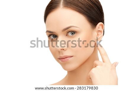 face of beautiful woman touching her ear