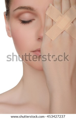 face of beautiful woman with plaster on his hand isolated on white