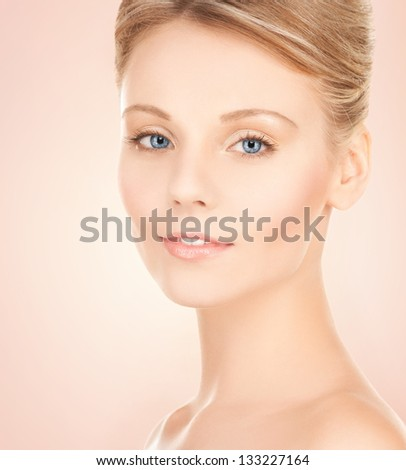 face of beautiful woman with updo hair - stock photo