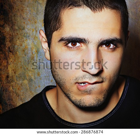 face of beautiful young man - stock photo
