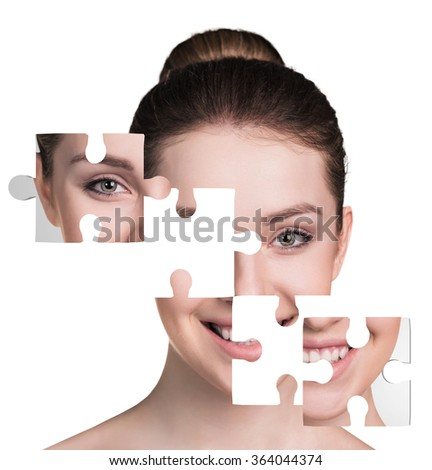 Face of  beautiful young woman with a puzzle parts