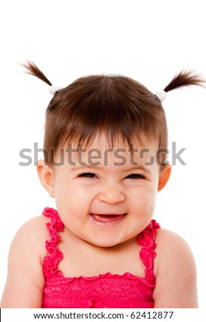 Face of cute happy smiling laughing baby infant girl with ponytails giggling, isolated.