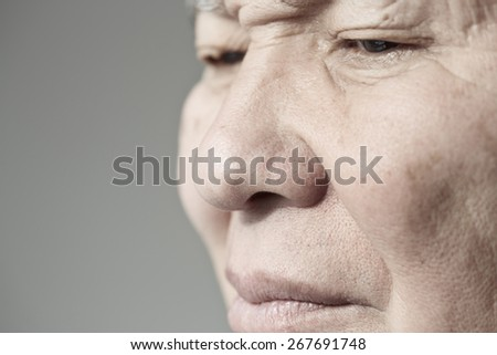 Face of elderly man looking away. Horizontal photo - stock photo